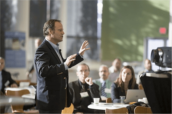 Man presenting to group of people